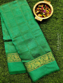 Semi raw silk saree green with self emboss pattern and paisley zari woven border