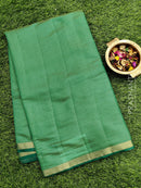 Semi raw silk saree green with half diamond zari border and self embose pattern
