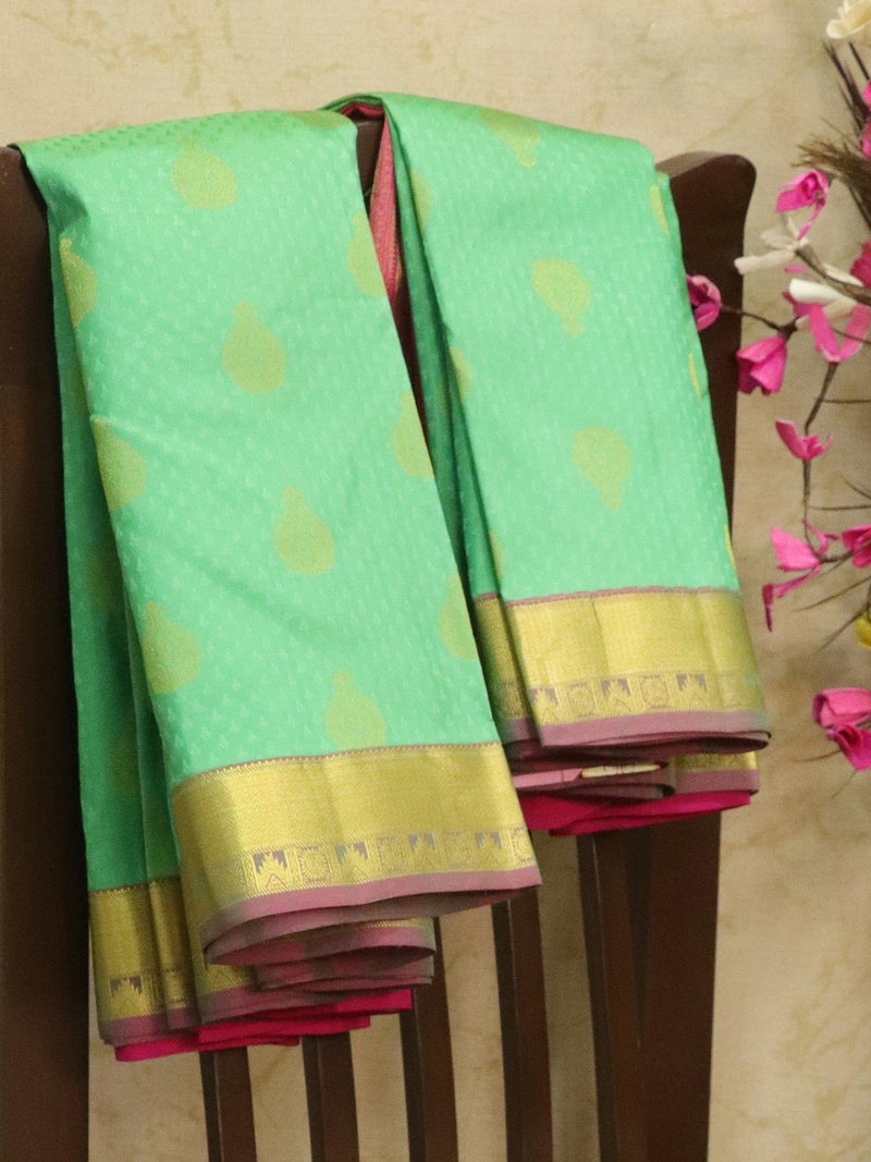 Pure kanjivaram silk sareee teal green and pink with allover self emboss and woven buttas with rich border