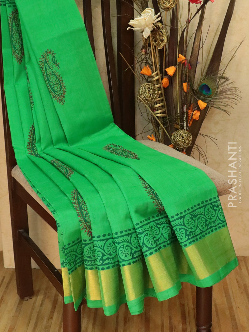 Block printed silk cotton saree green with paisley prints and golden zari border