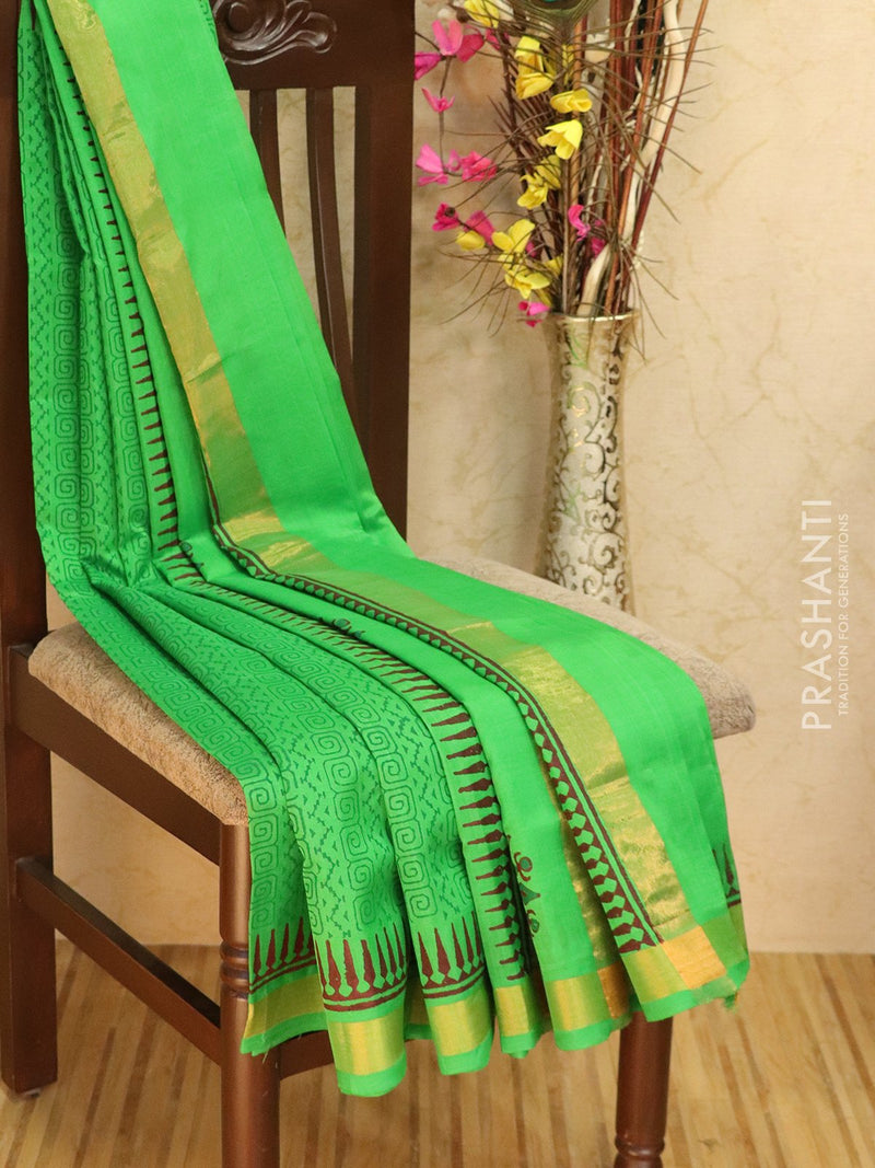 Block printed silk cotton saree green with all over prints and simple zari border
