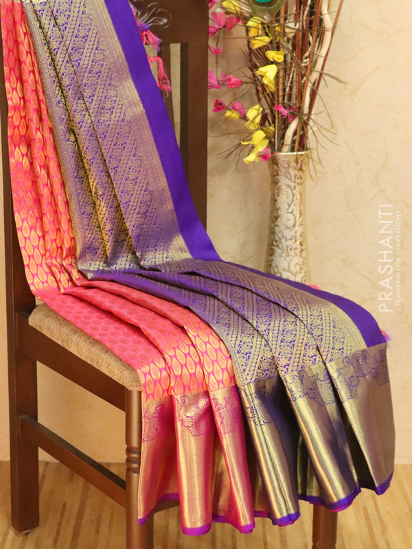 Pure kanjivaram silk sareee pink and dual shade of purple with allover zari buttas and rich zari border