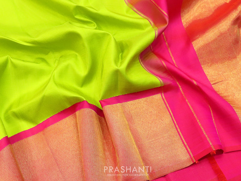 Pure kanjivaram silk sareee pista green and pink with plain body and rich golden zari border