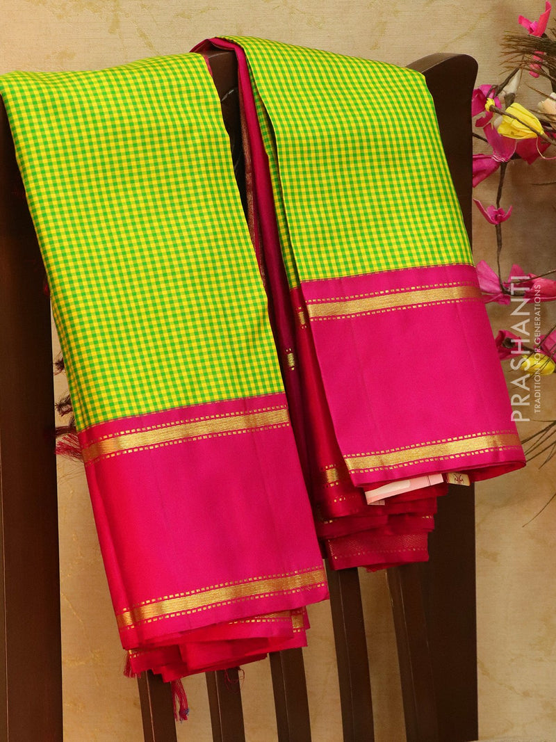 Pure kanjivaram silk sareee yellow green and pink with smaller checks in body and rettapet border