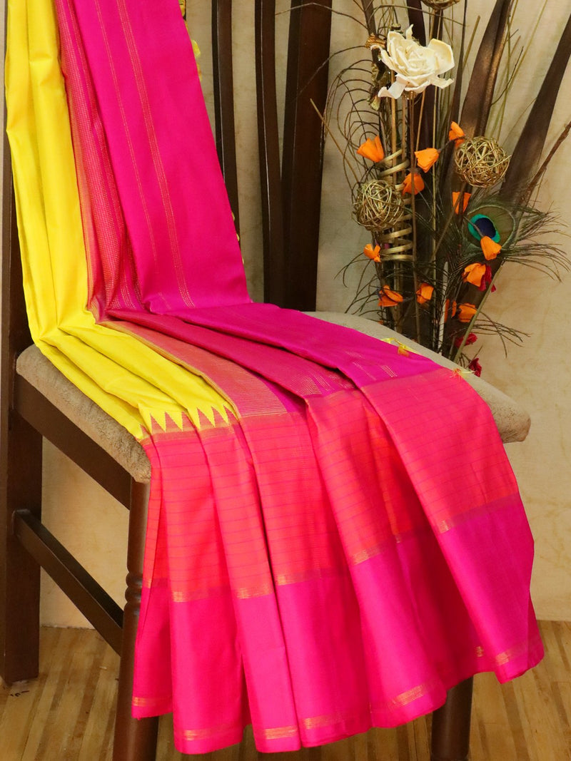 Pure kanjivaram silk sareee lime yellow and pink with plain body and long simple border