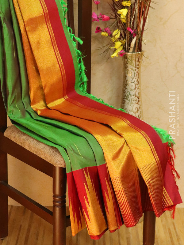 Pure kanjivaram silk sareee green and maroon with zari lines and rich temple zari border