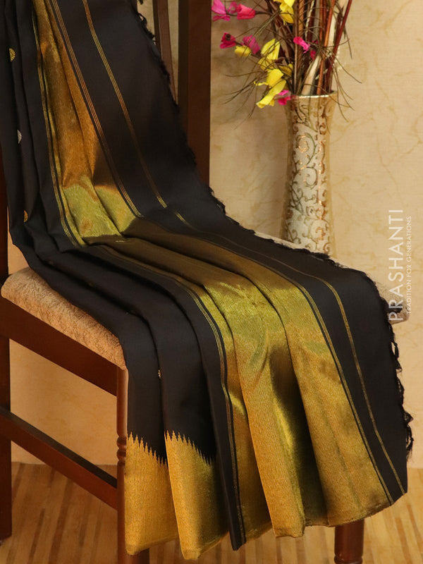 Pure kanjivaram silk sareee black with floral zari woven buttas and rich zari border