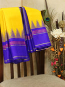 Pure kanjivaram silk sareee yellow and blue with plain body and thread woven temple border