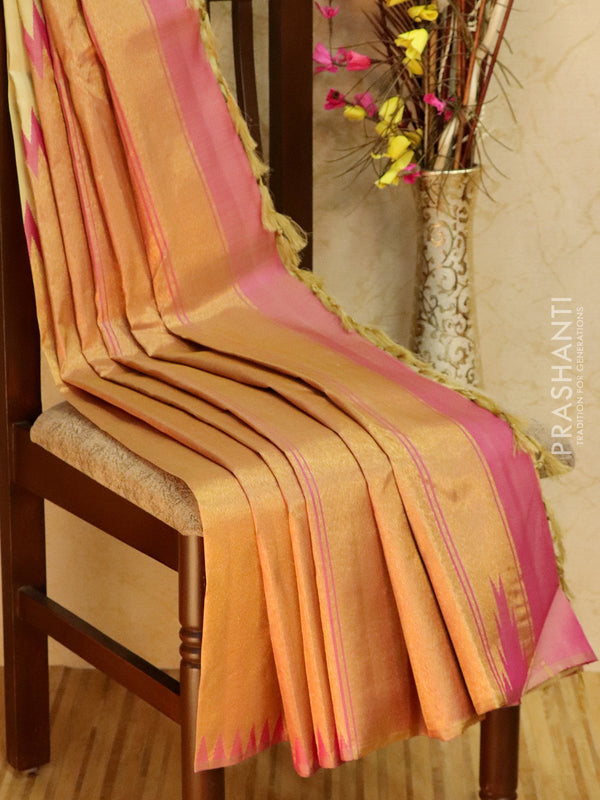 Pure kanjivaram silk sareee cream and pink with golden zari border half and half style