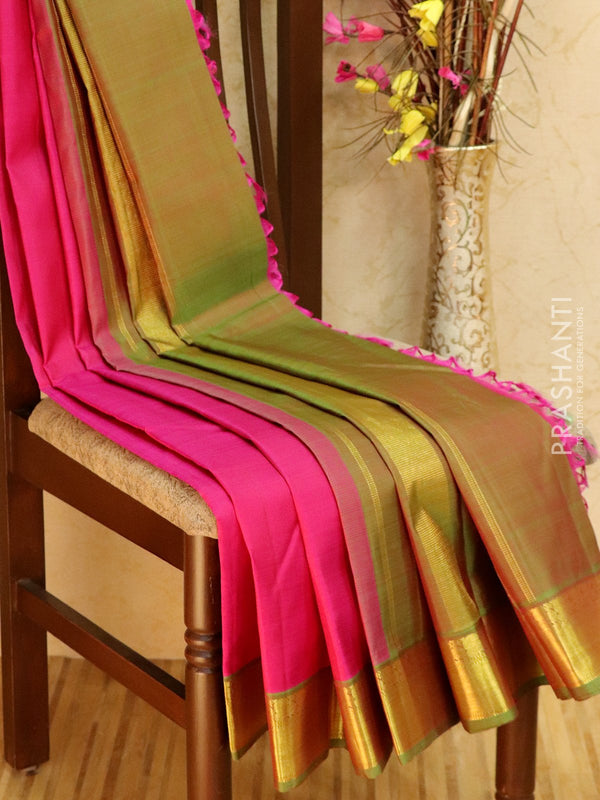 Pure kanjivaram silk sareee pink and green with plain body and zari woven border