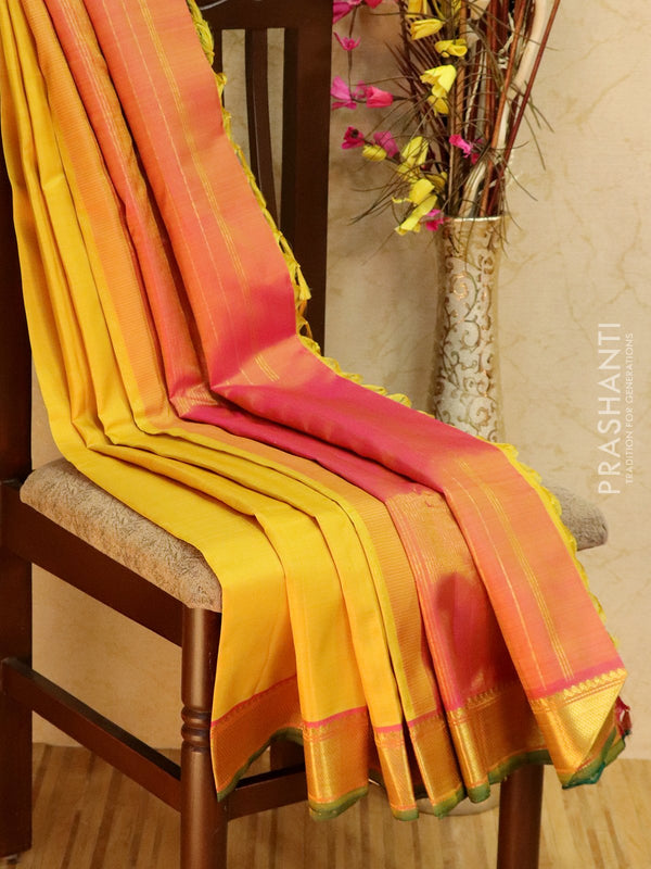 Pure kanjivaram silk sareee yellow and pink with plain body and zari woven border