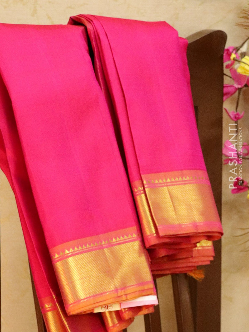 Pure kanjivaram silk sareee pink and mustard with plain body and zari woven border