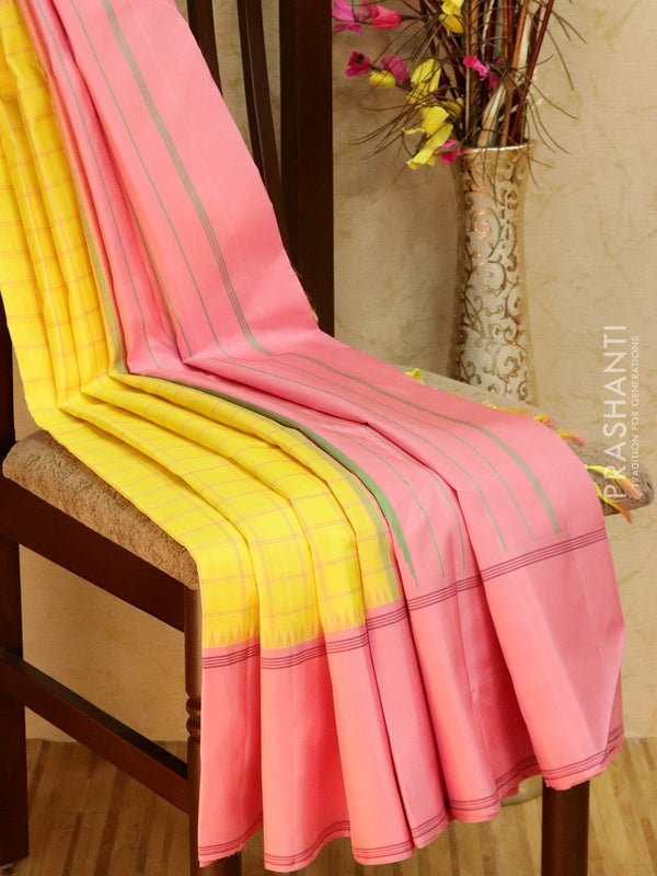 Pure kanjivaram silk sareee lime yellow and pink with checked body pattern and simple border
