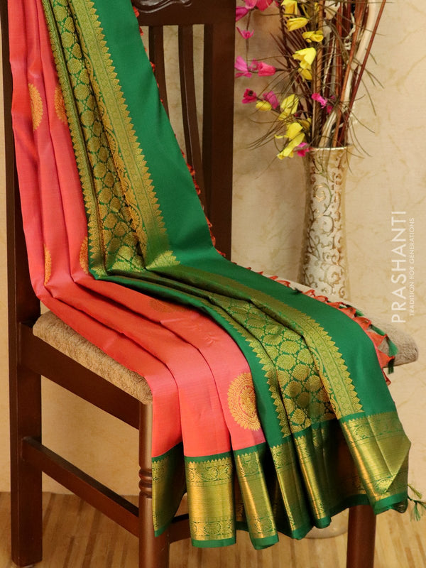 Pure kanjivaram silk sareee pastel pink and green with zari buttas and rich zari woven border