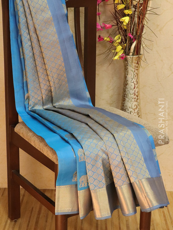 Pure kanjivaram silk sareee light blue and grey with peacock zari buttas and rich zari border