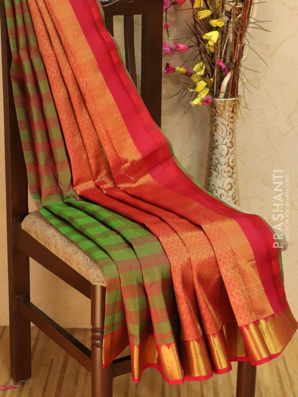 Pure kanjivaram silk sareee dual shade of green and red with plain body and temple zari border