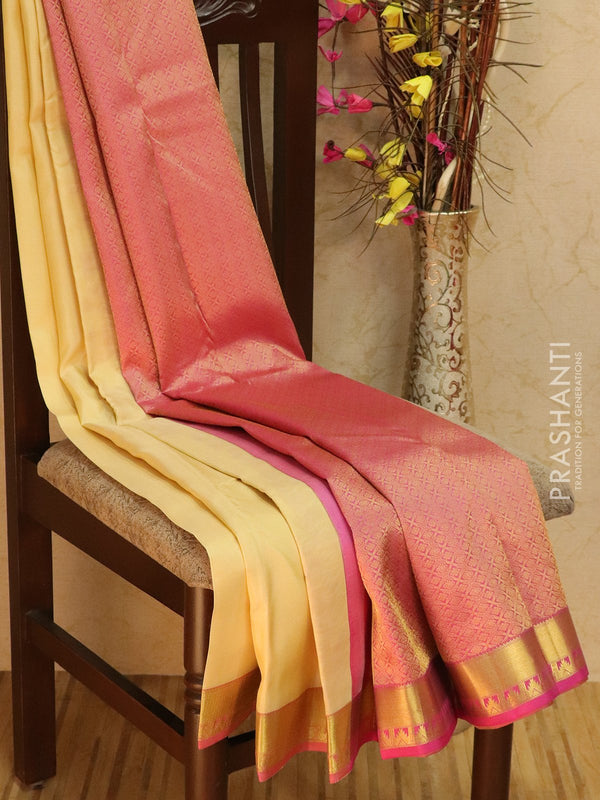 Pure kanjivaram silk sareee sandal and pink with plain body and zari woven temple border