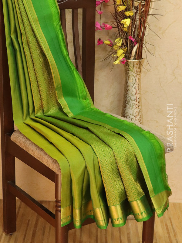 Pure kanjivaram silk sareee dual shade of green with plain body and zari woven temple border