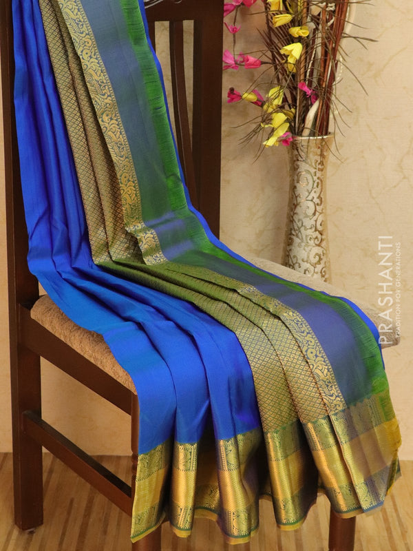 Pure kanjivaram silk sareee dark blue and green with plain body and rich zari woven border