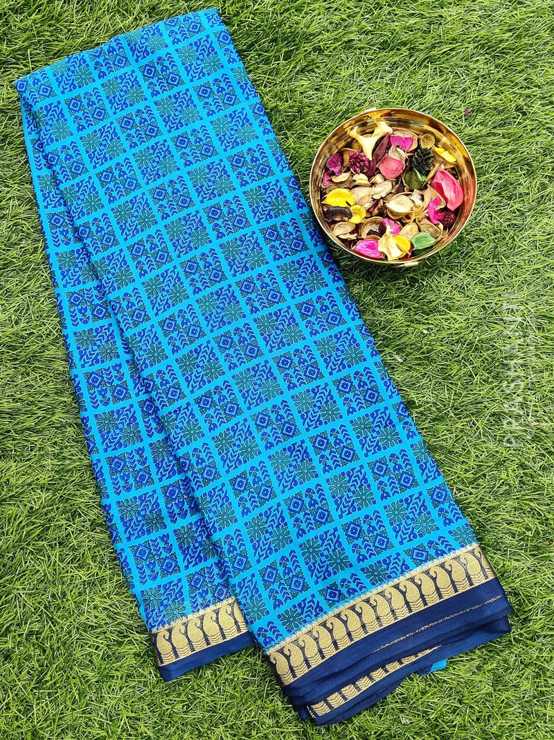 Semi Crepe Saree cs blue and blue with all over prints and golden zari border