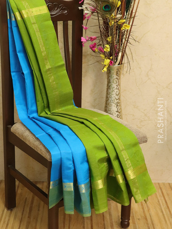 Silk cotton sarees blue and green with simple zari woven border