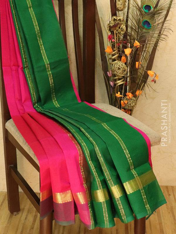 Silk cotton sarees pink and green with simple zari woven border