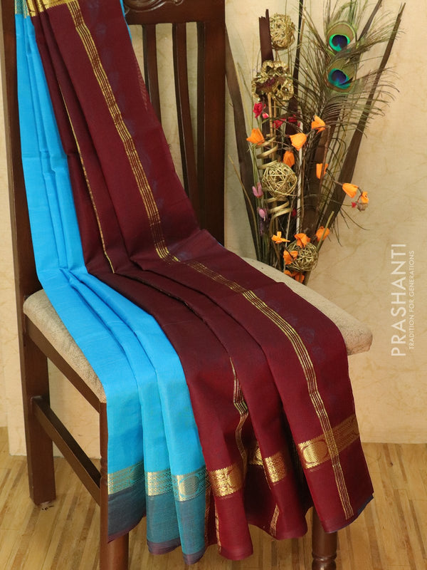 Silk cotton sarees cs blue and coffee brown with simple zari woven border