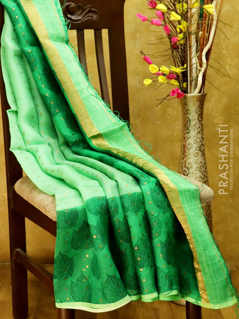 Organsa sarees green with leaf prints and seequin work with pipining border
