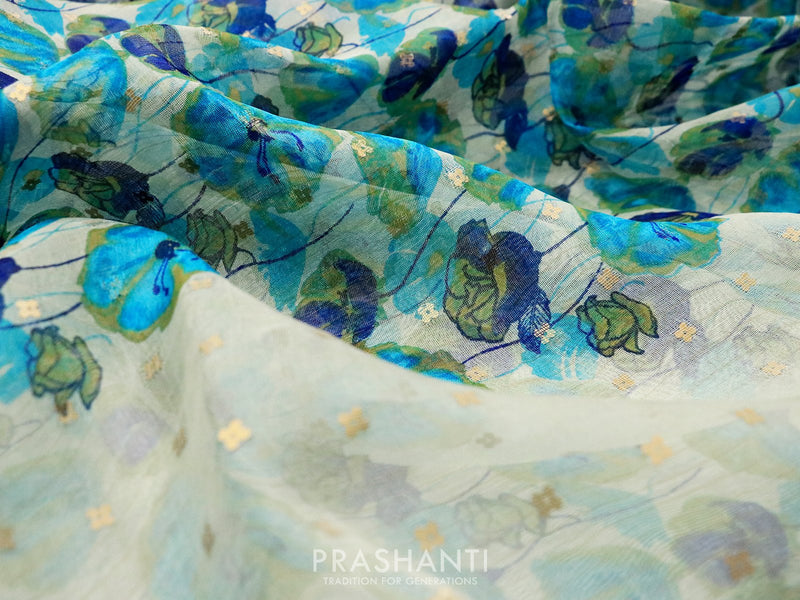 Organsa sarees off white and blue with all over floral prints and seequin work piping border