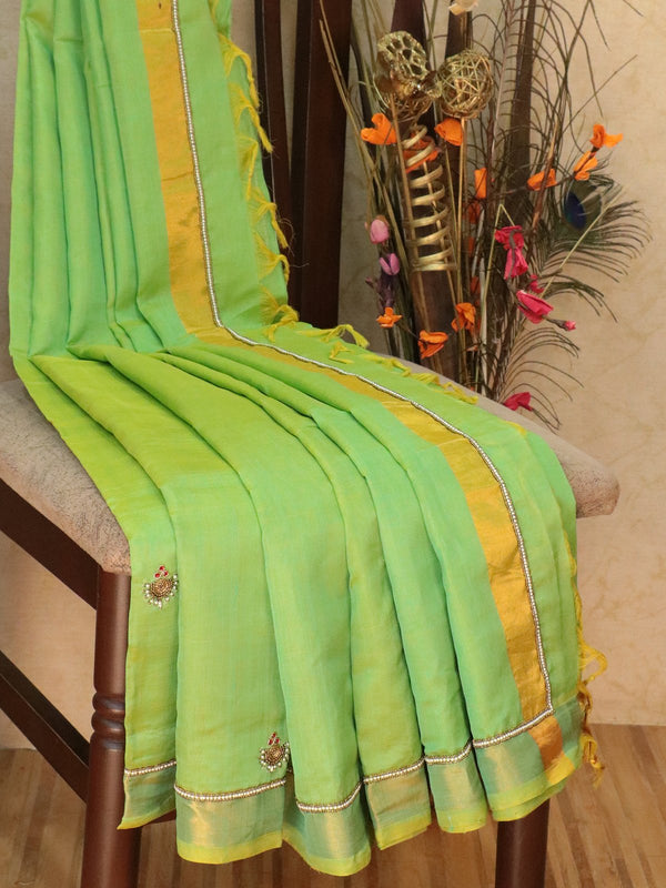 Silk Cotton saree light green with hand embroidery and golden zari border