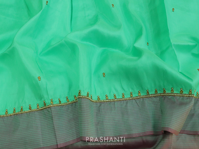 Silk saree teal and dual shade of purple with hand embroidery and zariless border