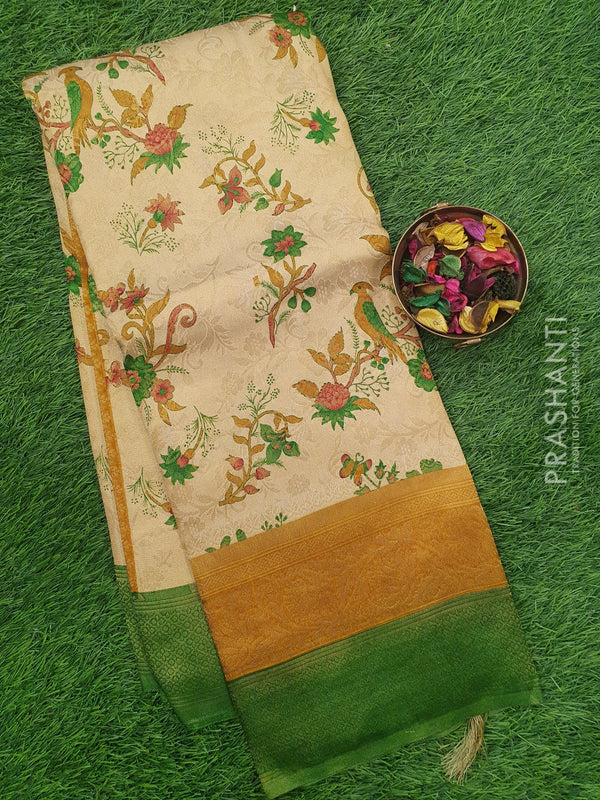Semi silk saree beige and green with all over zari weaving and floral prints