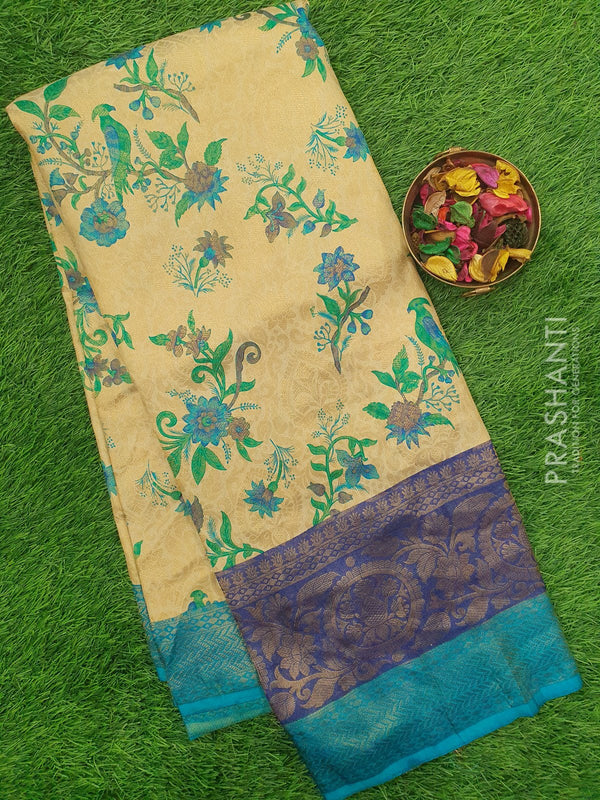 Semi silk saree beige and blue with all over zari weaving and floral prints