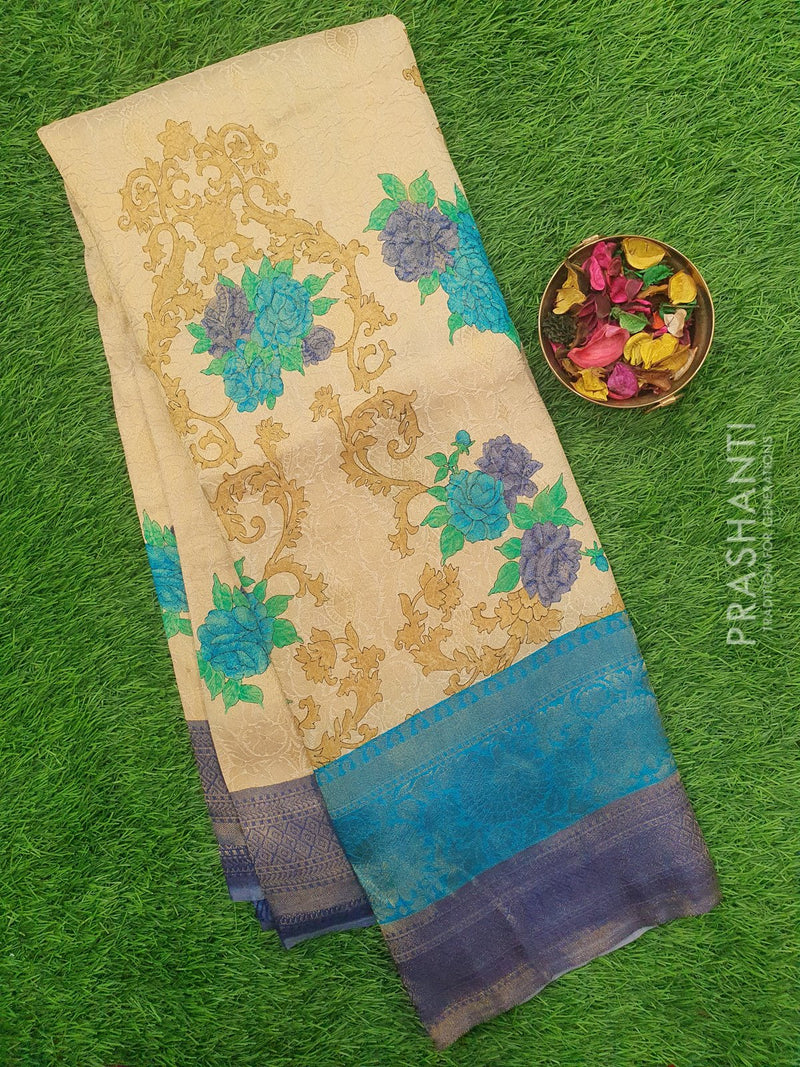 Semi silk saree cream and blue with rich zari weaving and all over prints