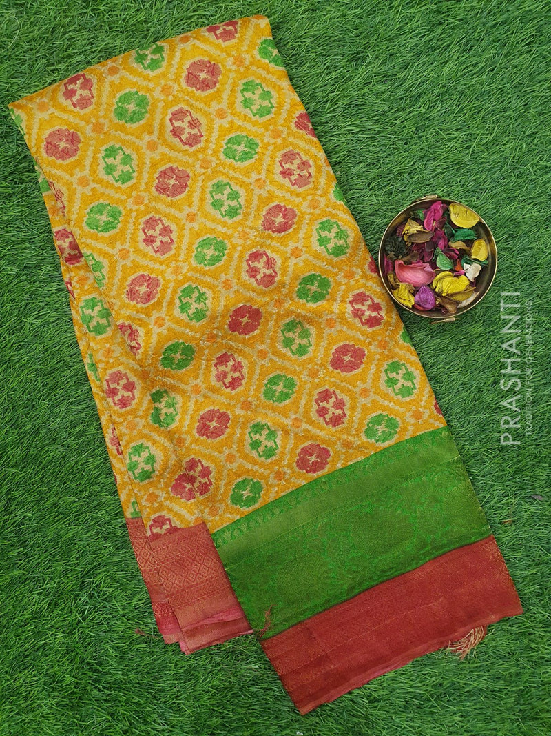 Semi silk saree rust and pink with rich zari weaving and all over prints