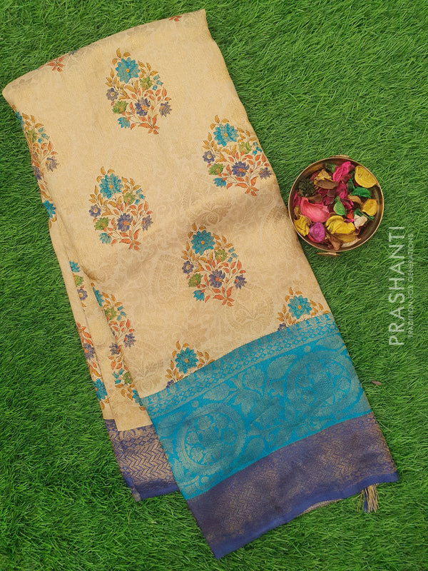 Semi silk saree beige and navy ble with rich zari weaving and all over prints