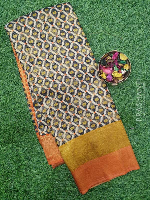 Semi silk saree black and rust orange with rich zari weaving and all over prints
