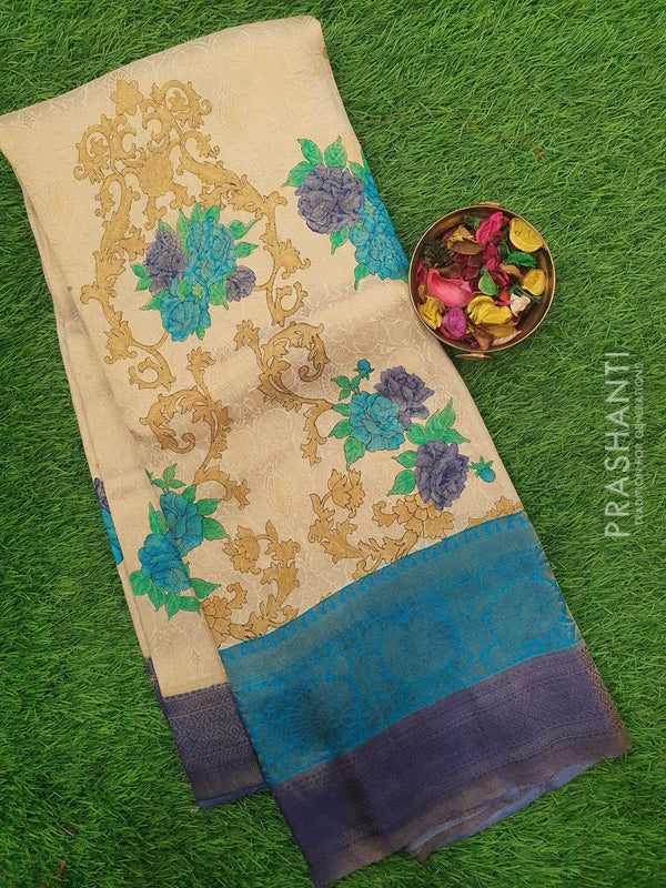 Semi silk saree beige and blue with rich zari weaving and all over prints