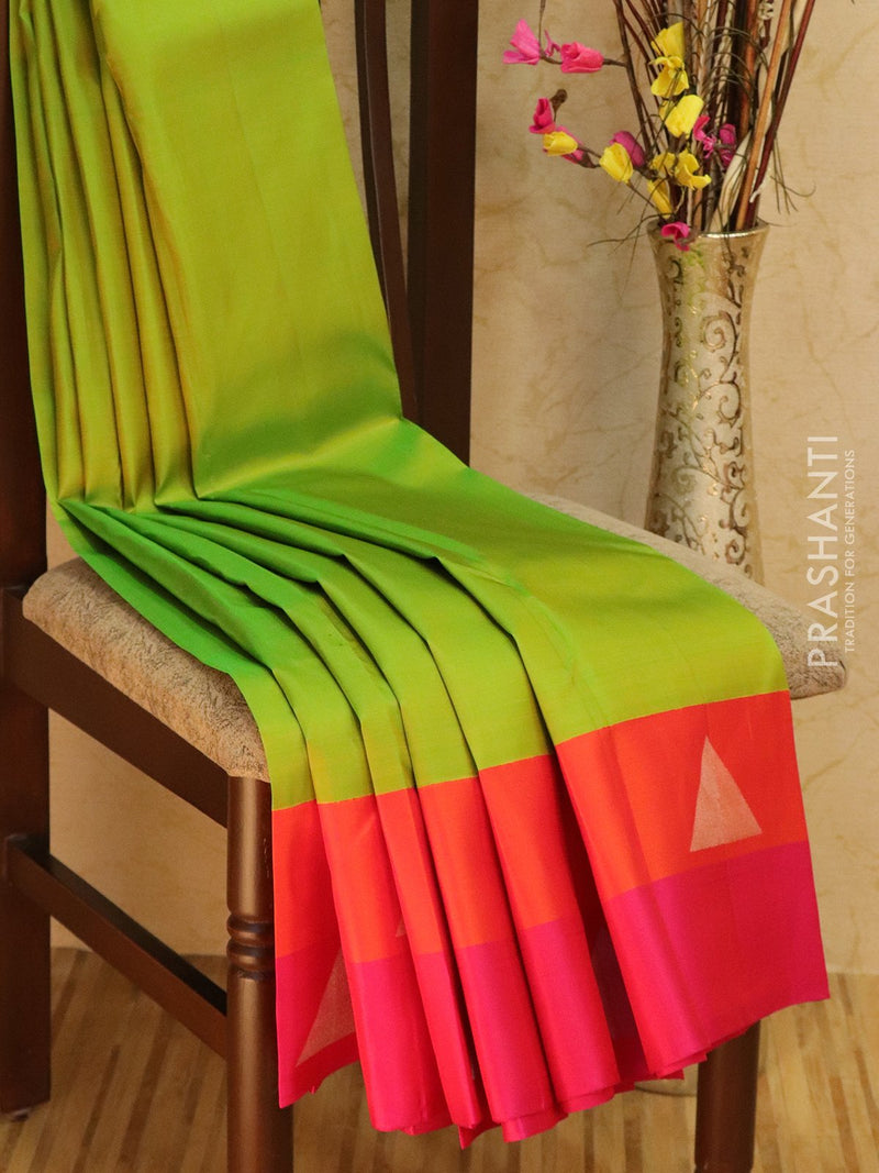 Pure Kanjivaram Silk saree lime green and pink with geometirc silver zari buttas style border