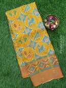 Semi Tussar saree mustard yellow and rust with ikkat prints and zari woven border