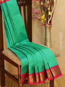 Silk cotton saree teal green and pink with zari woven korvai border