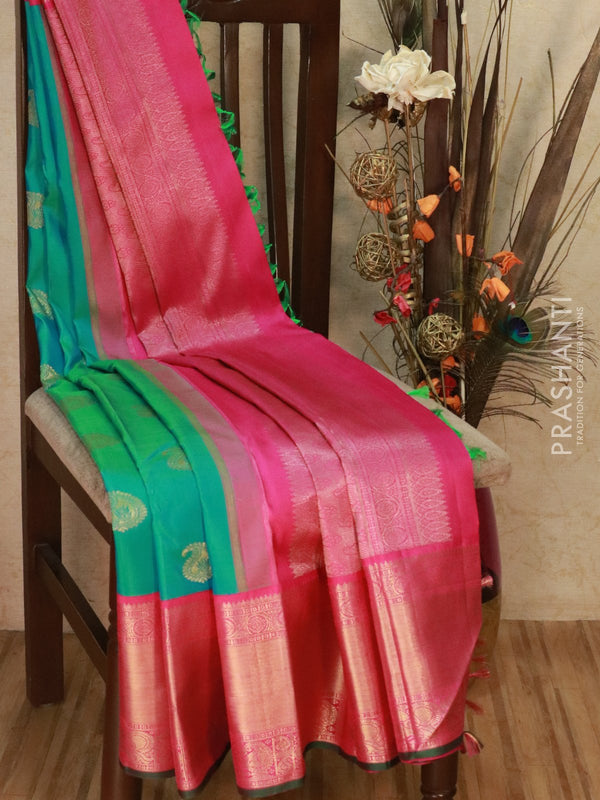 Pure Kanjivaram silk saree dual shade of blue and pink with paisley zari butta and golden zari border
