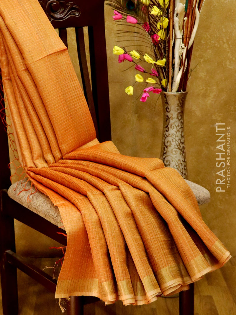Dupion Silk saree rust with allover zari checks and zari border