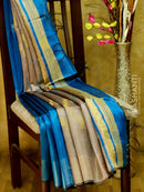 Dupion Silk saree beige and peacock blue with geometric thread weavings and golden zari border