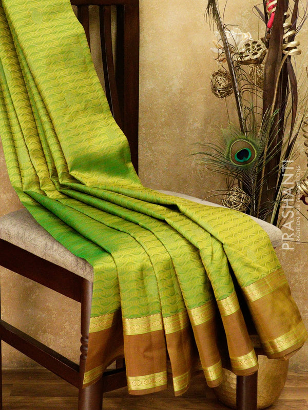 Kanjivaram silk saree dual green and brown with allover self emboss and thread buttas and border