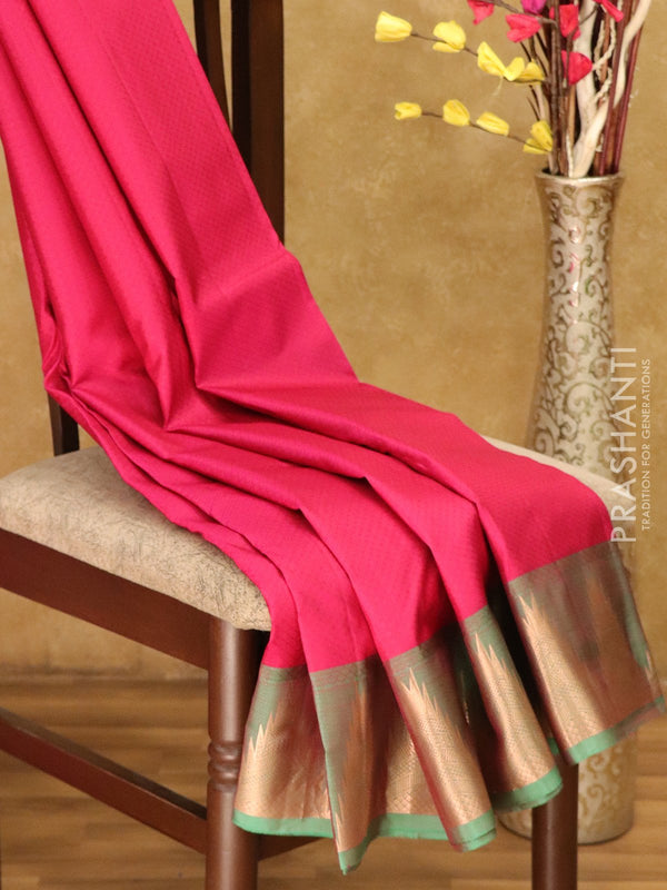 Kanjivaram Silk Saree tomato pink and green with allover self emboss and golden zari temple border