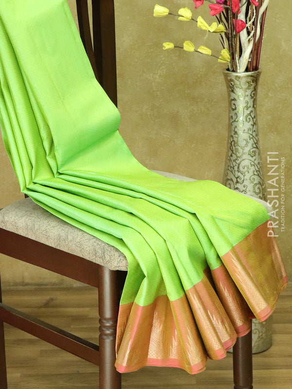 Kanjivaram Silk Saree lime green and pink with allover self emboss and golden zari temple border