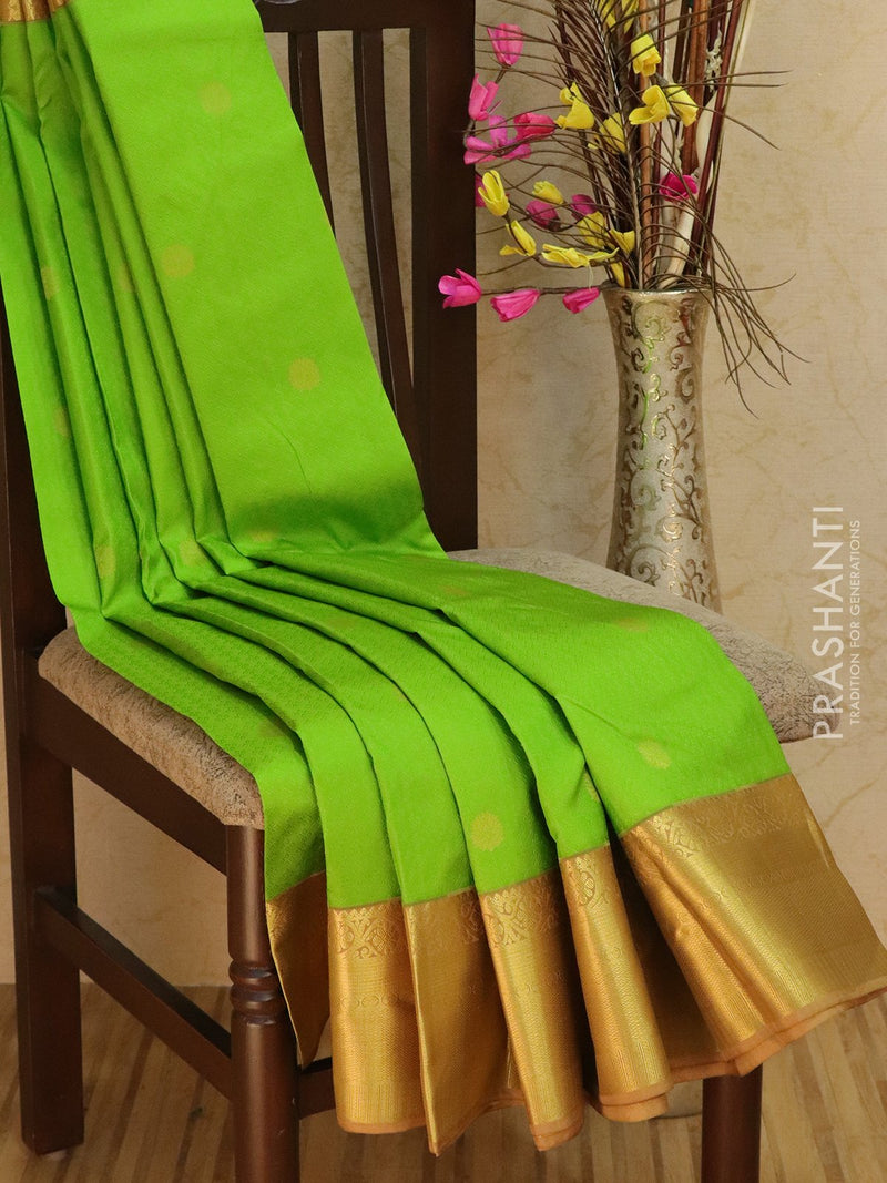 Pure Kanjivaram Silk Saree green and beige with self emboss and golden zari buttas with rich border