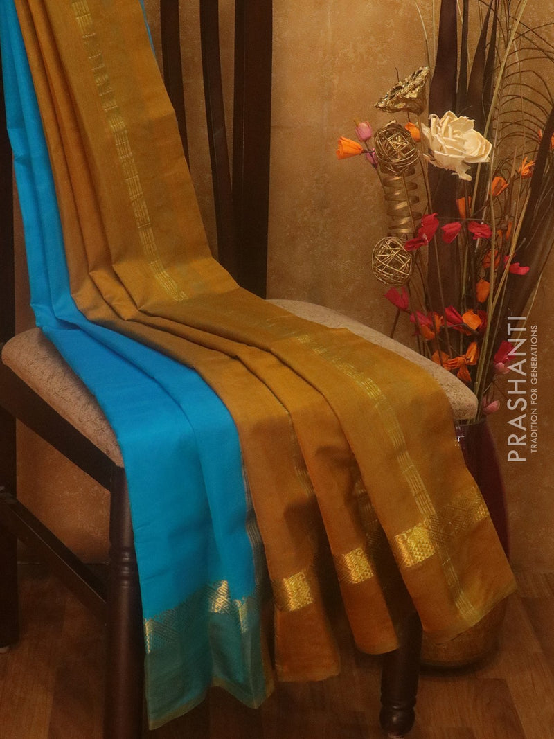 Silk cotton saree cs blue and mehendi green with simple zari border