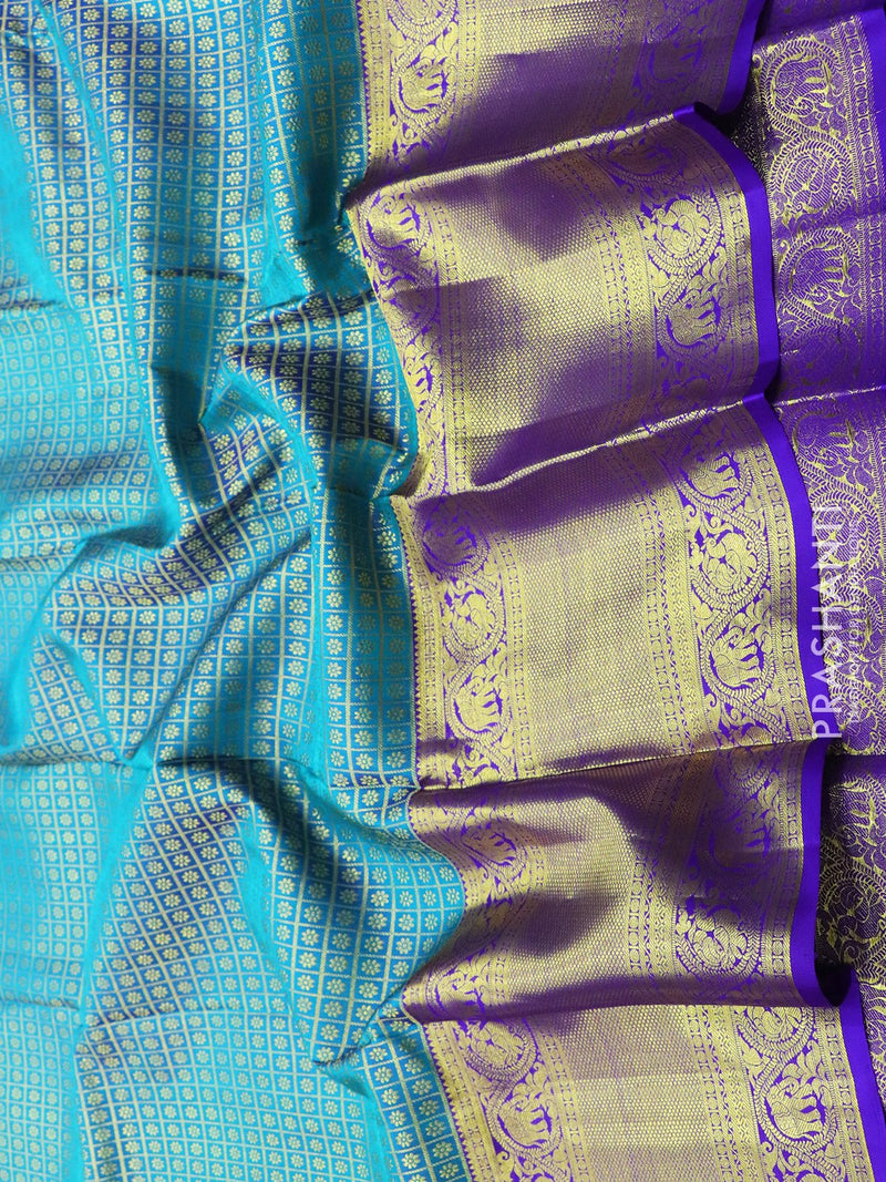 Pure Kanjivaram silk saree blue and violet zari checked all over floral buttas with rich traditional zari border